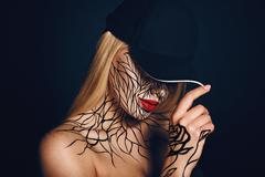 Fashion portrait of girl with faceart and red lips. Picture taken in the stud Stock Photos