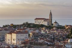 Cityscape with Cathedral of St George Piran Istria Slovenian Littoral Slovenia - stock photo