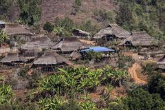 Typical thatched huts in a mountain village of the Ann tribe at Pin Tauk Shan Stock Photos