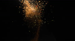 Camera follows spices flying after exploded. Slow Motion. Stock Footage