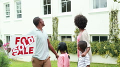 Happy family outside their new home Stock Footage