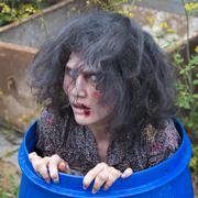 Zombie in a rain barrel film shooting scene from a zombie comedy short film Stock Photos