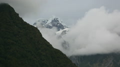 Snowy mountain peak with clouds rolling across Stock Footage