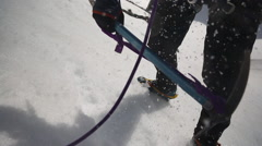 Climber ice picking in the snow Stock Footage