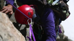 Climber on a rock face - stock footage