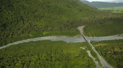 Aerial flight of bridge over a river in the mountains of New Zealand Stock Footage