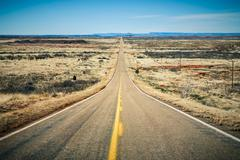 Stock Photo of Long straight desert road stretching into the distance to the horizon Route 66