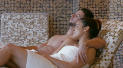 Couple relaxing in thermal suite Stock Footage