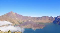 Active volcano smoking mount rinjani indonesia Stock Footage