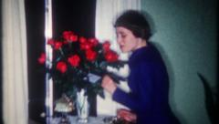 2596 - a dozen roses for young woman - vintage film home movie Stock Footage