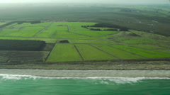 Aerial footage of farmlands and sandy coastline near The Catlins, New Zealand Stock Footage