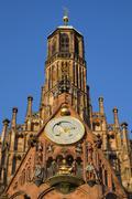 Stock Photo of Clock and figurines Mannleinlaufen Church of Our Lady Sebalder Altstadt