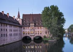 Heilig Geist Spital infirmary beside the Pegnitz river historic centre - stock photo