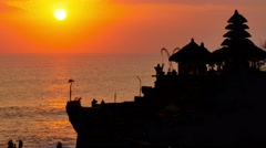 Famous temple tanah lot on the ocean at the sunset bali indonesia Stock Footage