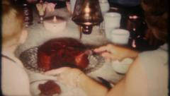 2601 - cake & ice cream for family at kitchen table - vintage film home movie Stock Footage
