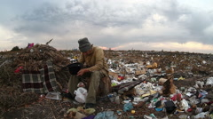 Man unemployed dump homeless dirty looking food waste in landfill  social video Stock Footage