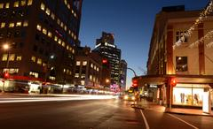 Traffic on Customs Street in Auckland Downtown at night - stock photo