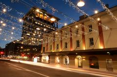 Traffic on Commerce Street in Auckland Downtown at night - stock photo