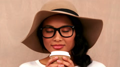 Gorgeous hipster drinking out of take-away cup Stock Footage