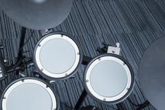 Electronic drum set in the room corner as musical background technology theme - stock photo