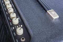 Stock Photo of Button of Guitar Power Amplifier, closeup view background