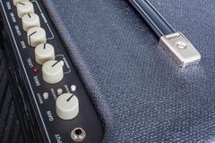 Button of Guitar Power Amplifier, closeup view background - stock photo
