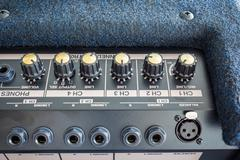 Button of Keyboard Power Amplifier, closeup view background - stock photo