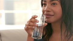Woman drinking glass of water - stock footage