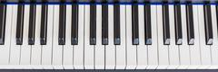 Piano Keyboard synthesizer closeup key top view - stock photo