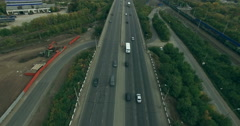 Flying over the busy road - stock footage