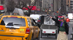 A woman hails a New York taxi in the rain. - stock footage