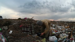 Man unemployed homeless dirty looking food waste dump in landfill  social video Stock Footage
