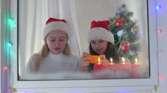 Children at home using new smart phone gifted for Christmas Stock Footage