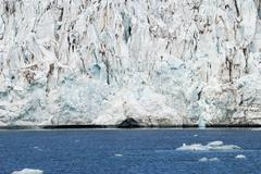 Icebergs in front of the glacier, Svalbard, Arctic - stock photo