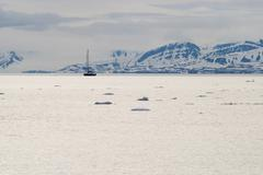 Icebergs floating in the arctic sea in Svalbard Stock Photos