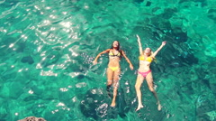 Luxury Resort Vacation. Beautiful Young Women Relaxing in Bikinis  - stock footage
