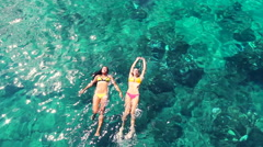 Luxury Resort Vacation. Beautiful Young Women Relaxing in Bikinis  - stock footage