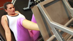 Pregnant woman using weights machine Arkistovideo