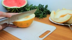 cutting ripe fragrant melons - stock footage