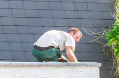 Repairman at work Stock Photos