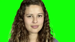 Young woman expresses joy and enthusiasm. Green screen background. - stock footage