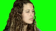 Young woman turns to camera, screams and looks terrified. Green screen. Stock Footage