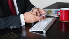 Business man's hand's texting on smartphone. - stock footage