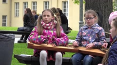 Girls with teacher play with string instruments. 4K Stock Footage