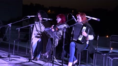 lady woman band play guitar and sing poetry at night. 4K - stock footage