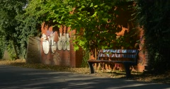 Empty Wooden Bench Graffity Painted on the Wall Painted on the Bench Red Bricks Stock Footage