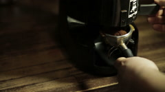 Stock Video Footage of Bartender grinding coffee for espresso in restaurant