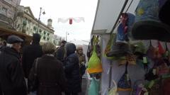Market with handmade leather bag and felt cap on kiosk. 4K Stock Footage