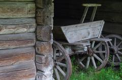 Old wooden cart in coach-house - stock photo