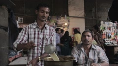 Local vendor making tea at his stall. Stock Footage